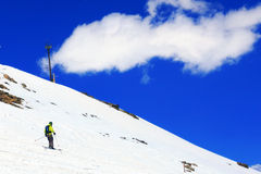 A skier descending Mount Elbrus - peak in Europe. Royalty Free Stock Images
