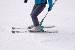 A skier descends from the mountain Royalty Free Stock Photo