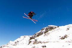 Skier doing big air. Skier pulling off a spectacular move in snowpark. Trademarks have been removed Stock Photo