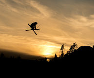 Skier doing a grab off  jump in the sunset Royalty Free Stock Photos