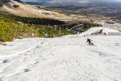 Skier during downhill skiing. Stock Image