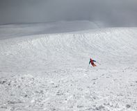 Skier downhill on snowy freeride slope and overcast misty sky be. Fore blizzard. Caucasus Mountains in winter at bad weather, Georgia, region Gudauri Royalty Free Stock Images