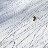 Skier downhill on snowy ski slope for freeride. At sun winter day after snowfall Royalty Free Stock Photos