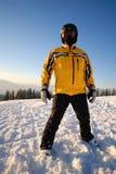 Skier dressing yellow coat. In a black helmet Royalty Free Stock Photos