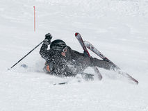 Skier fall on the ski slope. Stock Images