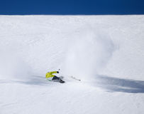 Skier falling down on mountain slope. Young male skier falling down on mountain slope Stock Photo