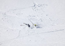 Skier after falling down on mountain slope. Male skier after falling down on mountain slope Stock Image