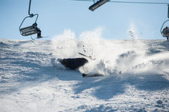 Skier falling with fresh snow powder on the slope Stock Images