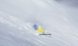 Skier falling on the slope Royalty Free Stock Photos