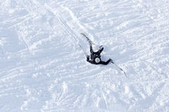 The skier fell in the snow at speed Stock Photo