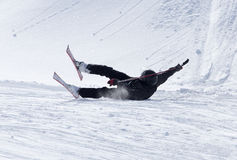 The skier fell in the snow at speed Stock Images