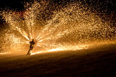 Skier with fireworks attached to his back Royalty Free Stock Photography