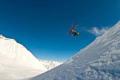 Skier flying in the air. Caucasus mountains Royalty Free Stock Image