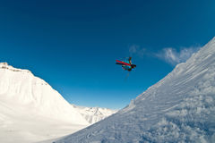 Skier flying in the air. Caucasus mountains Stock Photos