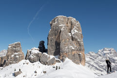 Skier in front of the Cinque Torri peaks. Woman skier in front of the Cinque Torri peaks, near the village of Cortina, Dolomiti Royalty Free Stock Photos