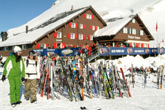 Skier in front of a restaurant on the ski slopes at Engelberg Royalty Free Stock Photography
