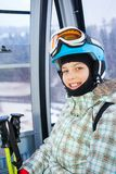 Skier girl on ski lift. Ski lift, skiing, ski resort - happy skier girl on ski lift stock photography