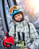 Skier girl on ski lift. Ski lift, skiing, ski resort - happy skier girl on ski lift royalty free stock photography