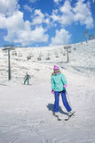 Skier girl on a ski resort. In the mountains stock photos