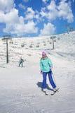 Skier girl on a ski resort. In the mountains Stock Photos