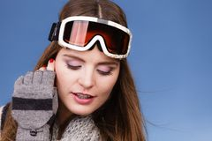 Skier girl wearing warm clothes ski googles portrait. Woman skier girl wearing warm clothing ski googles portrait. Winter sport activity. Beautiful sportswoman royalty free stock image