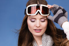 Skier girl wearing warm clothes ski googles portrait. Royalty Free Stock Image