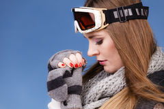 Skier girl wearing warm clothes ski googles portrait. Woman skier girl wearing warm clothing ski googles portrait. Winter sport activity. Beautiful sportswoman royalty free stock photography
