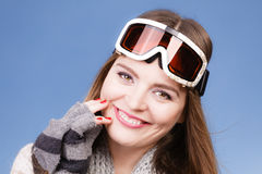 Skier girl wearing warm clothes ski googles portrait. Woman skier girl wearing warm clothing ski googles portrait. Winter sport activity. Beautiful sportswoman stock photo