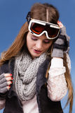 Skier girl wearing warm clothes ski googles portrait. Woman skier girl wearing warm clothing ski googles portrait. Winter sport activity. Beautiful sportswoman royalty free stock images