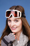Skier girl wearing warm clothes ski googles portrait. Woman skier girl wearing warm clothing ski googles portrait. Winter sport activity. Beautiful sportswoman royalty free stock photo