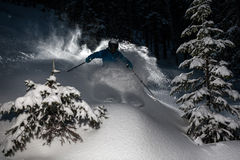 Skier go down powder snow. Freeriding on powder at night Stock Images