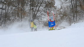 Skier is going down on downhill in slow motion stock footage