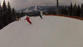 Skier going down the ski run in Bukovel stock footage