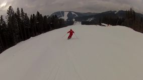 Skier going down the ski run in Bukovel stock video footage