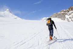 Skier going up of a mountain Royalty Free Stock Photography
