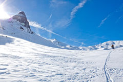 Skier going up of a mountain Royalty Free Stock Photos