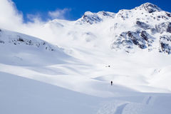 Skier going up of a mountain Royalty Free Stock Image
