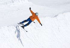 Skier on half pipe of Pradollano ski resort in Spain. Snowy ski slopes of Pradollano ski resort in the Sierra Nevada mountains in Spain with skier in half pipe Stock Images