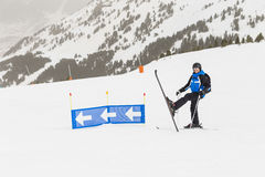 Skier having fun on top of the mountain. Playing with skis. Winter season. sports and lifestyle Royalty Free Stock Image