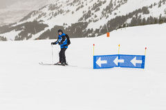 Skier having fun on top of the mountain. Playing with skis. Winter season. sports and lifestyle Stock Photos