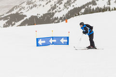 Skier having fun on top of the mountain. Playing with skis. Winter season. sports and lifestyle Stock Images