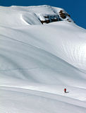 Skier in a heavily snowed-in countryside. Lonely skier doing a ski tour in the bavarian alps Stock Photos