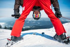 Skier in helmet and glasses, bottom view. Winter active sport, extreme lifestyle. Downhill or mountain skiing Stock Image