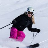 Skier in high mountains. During sunny day Royalty Free Stock Photo
