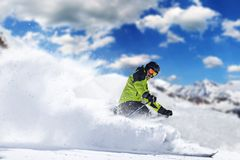 Skier in high mountains. During sunny day Stock Photos