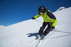 Skier in high mountains. During sunny day Stock Photo