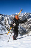 Skier hiking for fresh tracks Royalty Free Stock Photography
