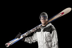 Skier holding a pair of skis Stock Photography
