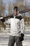 Skier holding a pair of skis Stock Photo