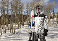 Skier holding a pair of skis Royalty Free Stock Photography